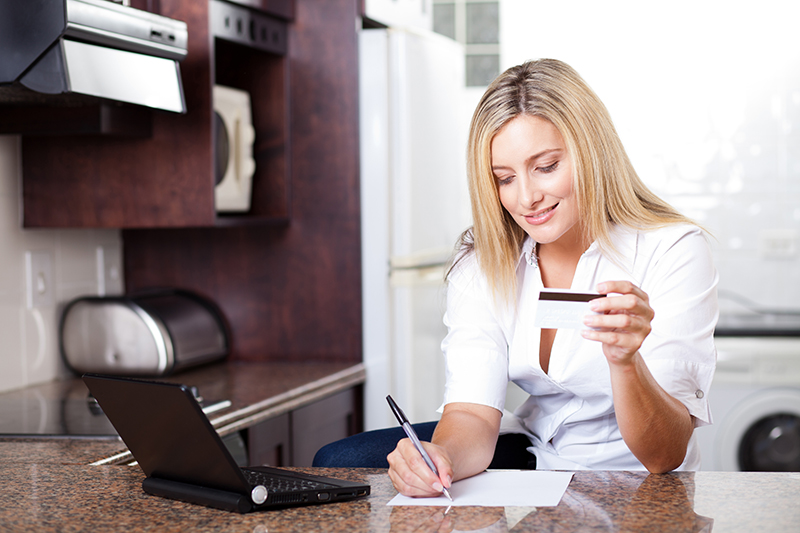 Woman doing money management paying bills