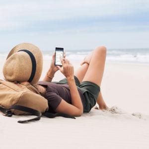 woman on mobile phone using ukrfcu app