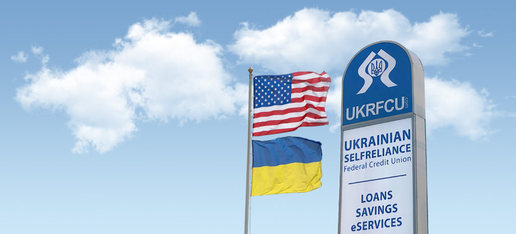 ukrainian american flag and ukrfcu sign waving right