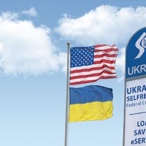 ukrainian american flag and ukrfcu sign waving right