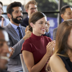 Audience applauding at annual meeting