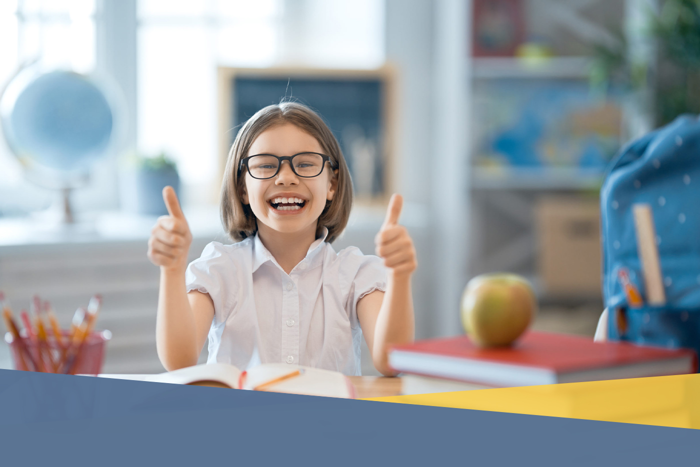 young student giving thumbs up
