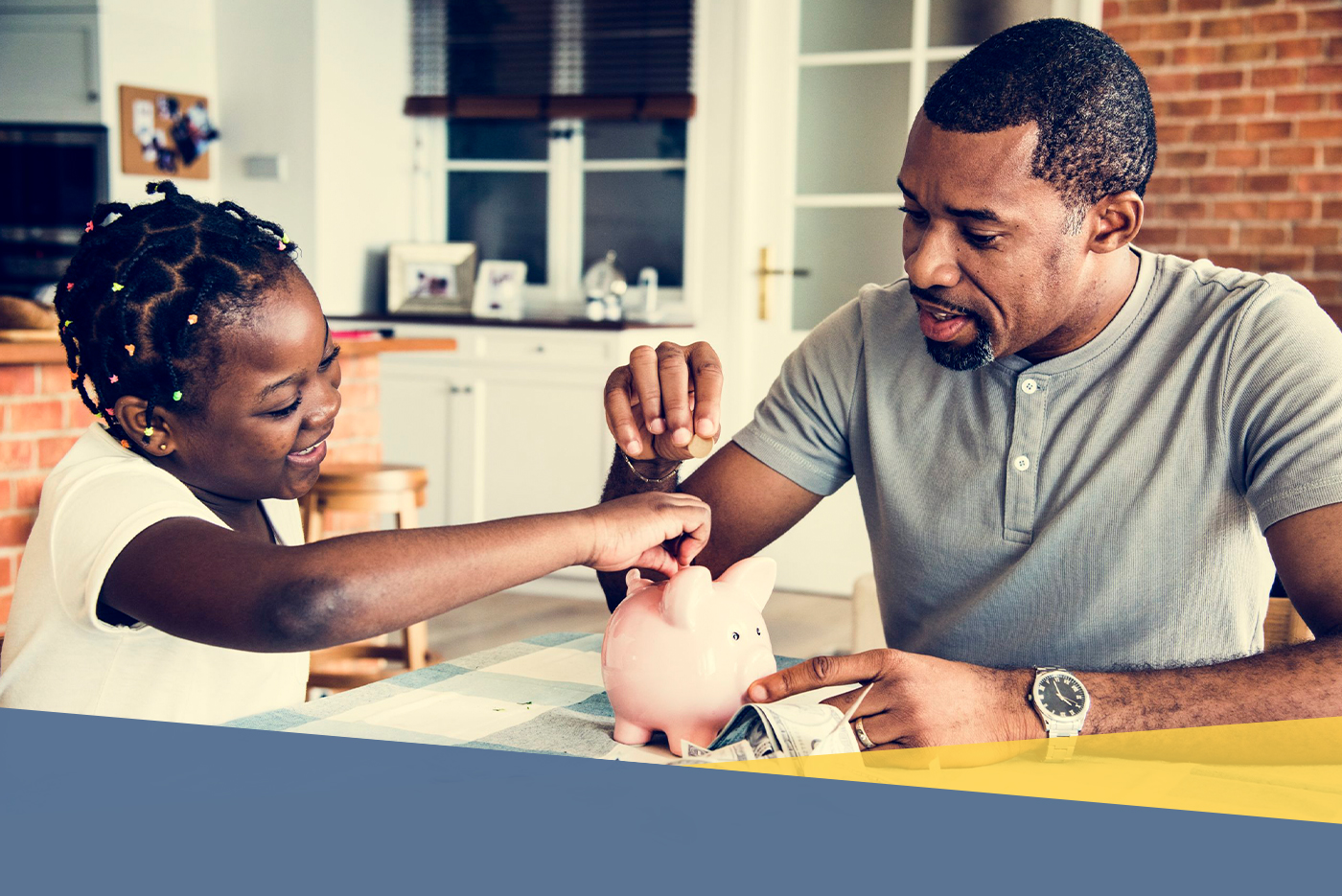 father teaching daughter hot to save money
