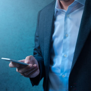 business individual looking at cell phone