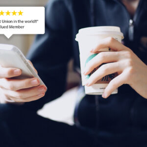 UKRFCU member reviewing branch on google and drinking coffee